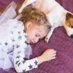 How Does Sharing a Bed with a Pet Impact Kids' Sleep?